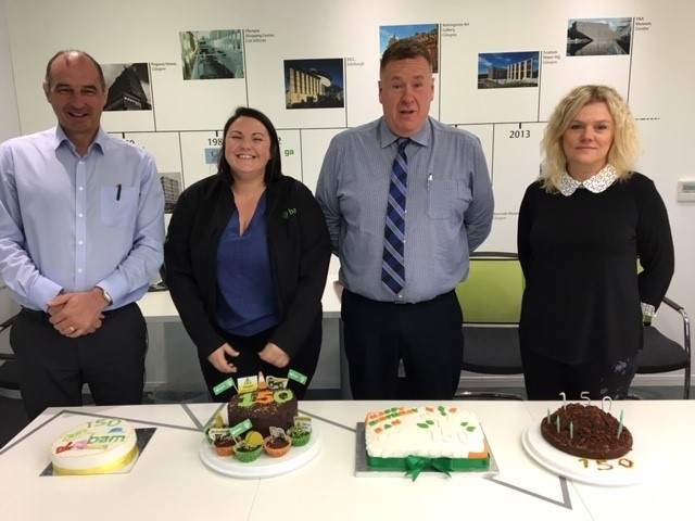 Bakers of the Edingburgh office with their cakes