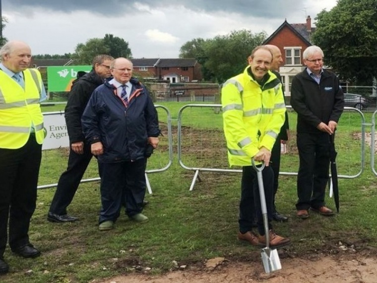 Sir James Bevan taking part in a sod turning event in the local community.