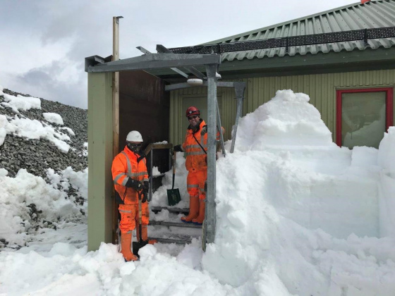 Construction team clearing snow to start work on building the new scientific support facility.