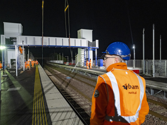 The installation of the footbridge at night