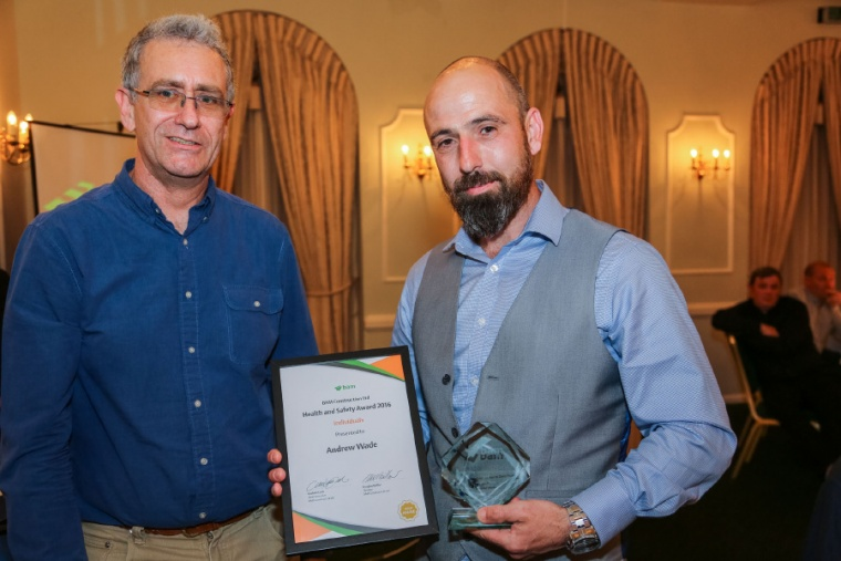 Mark Lockwood (left) presents Andrew Wade (right) with his health and safety award
